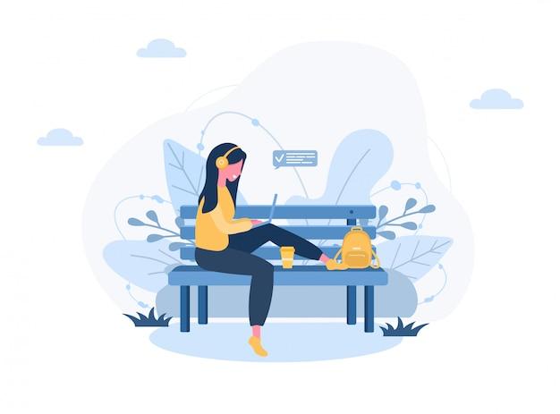 レディースフリーランス。公園のベンチに座っているラップトップを持つ少女。屋外での作業、勉強、コミュニケーション、健康的なライフスタイルの概念図。フラットスタイルのイラスト。