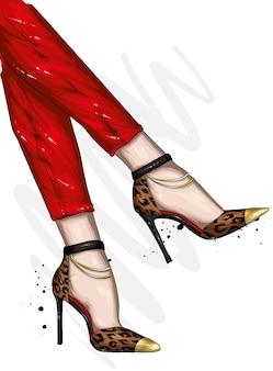 세련된 신발과 바지에 여성 다리