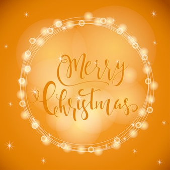 Wonderful and unique festive golden luminous background with christmas wishes for holiday greeting cards. hand drawn lettering with blurred bokeh. new year design elements.