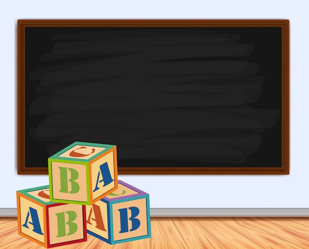 Wood cubes with letters and blackboard