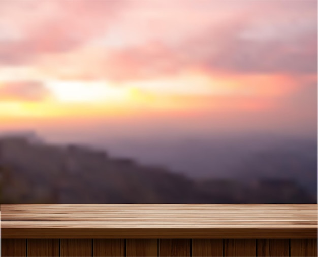 나무 테이블 상단 및 산 풍경 흐리게