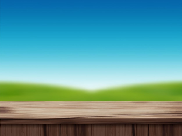Wood table top and blurred of blue sky landscape