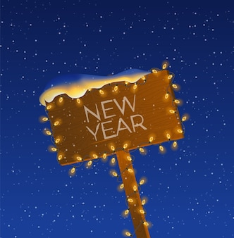 ウッドデンの道路標識とクリスマスライトの夜。