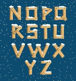 Wooden alphabet with snow