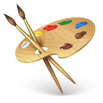 Wooden artist palette with paint brushes