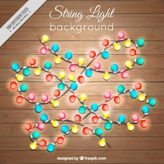 Wooden background with garlands of lights
