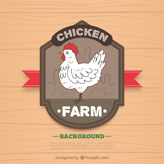Wooden background with hand drawn hen badge