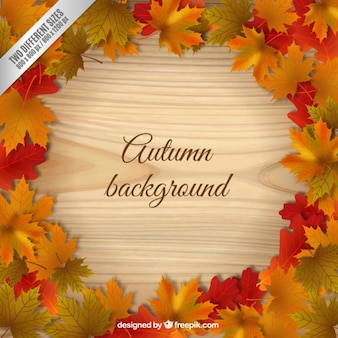 Wooden background with leaves