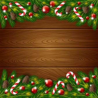 Wooden background and xmas fir tree with decoration