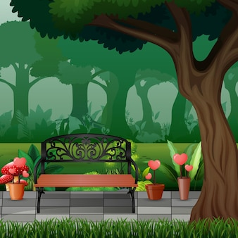 Деревянная скамейка под большим деревом в парке