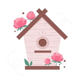꽃으로 장식된 나무 새집 새들에게 먹이를 주는 정원 새집