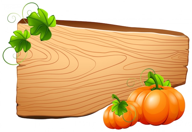 Wooden board and pumpkins on vine