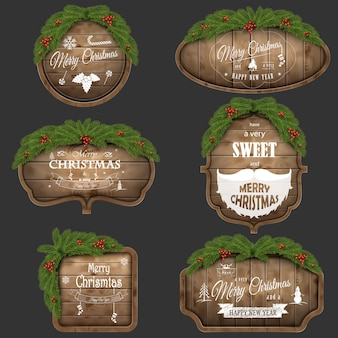 Wooden christmas board set with pine branches and holiday wishes.