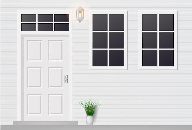 Wooden door of house front view with windows.