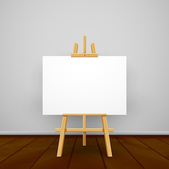Wooden easel canvas board on gray wall.