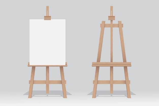 白い背景の上の空白のキャンバスと木製イーゼルスタンド