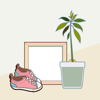 Wooden frame, sneakers and avocado plant.