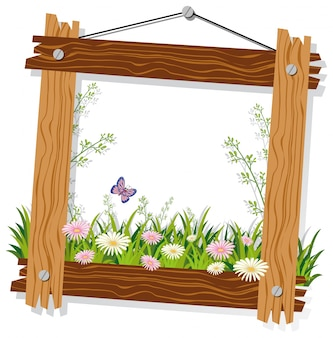 Wooden frame template with flowers and grass