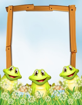 Wooden frame with frogs background