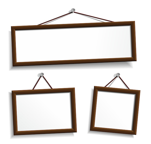 Wooden frames hanging on a nails.   elements  on white.