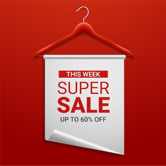 Wooden hanger with paper and the message about the sale offers
