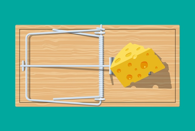 Wooden mouse trap with cheese, classical spring loaded bar trap.