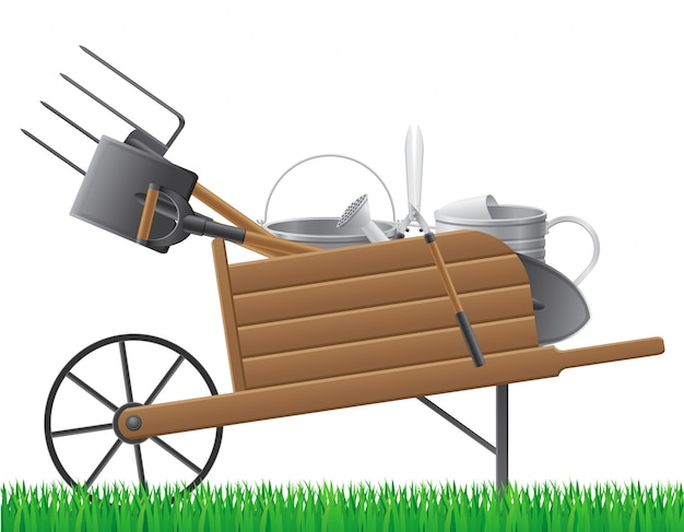 Wooden old retro garden wheelbarrow with tool.