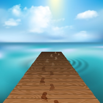 Wooden pier at sea with cloudscape