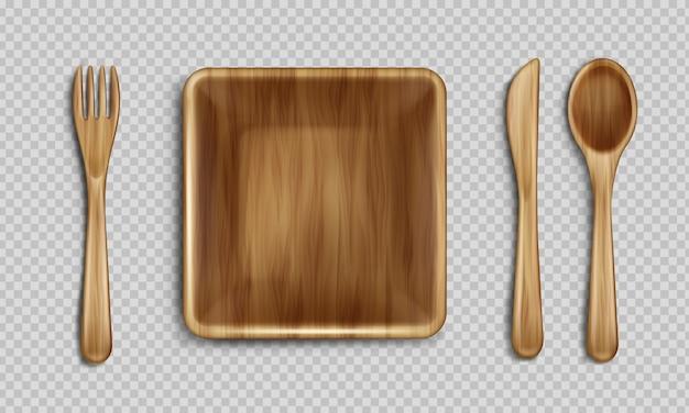 Деревянная тарелка, вилка, ложка и нож вид сверху.