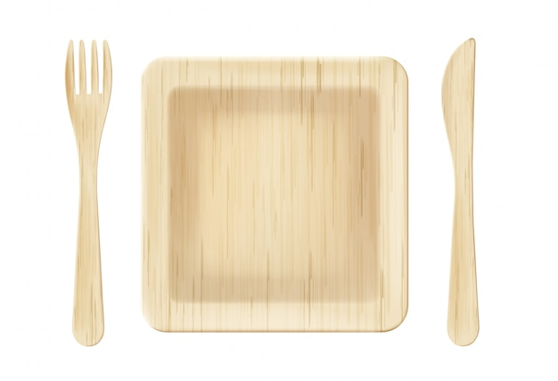 Wooden plate with fork and knife top view