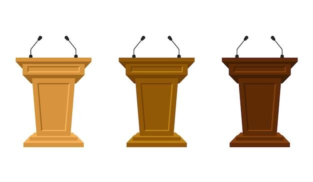 세 가지 색 트리뷴의 나무 세트는 마이크가 있는 연단을 서 있습니다. 연단 또는 받침대는 연설을 위한 스탠드 또는 연설자를 위한 공개 강단입니다. 기자 회견이나 미디어, 정치 커뮤니케이션에 대한 찬사.