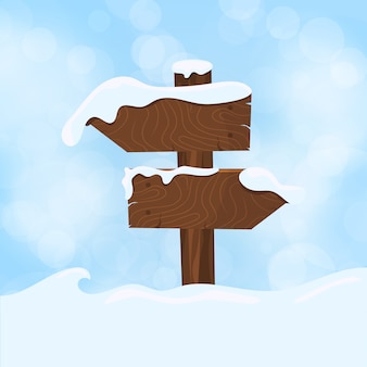 Wooden sign blank board and winter snow with copy