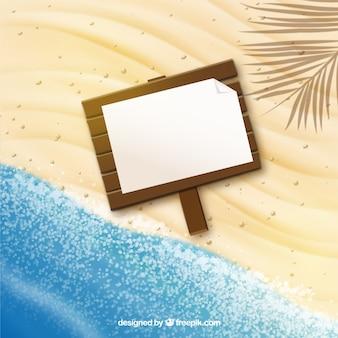 砂の上に木の看板
