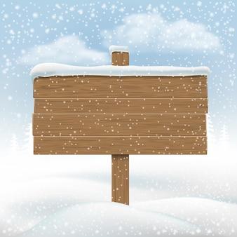 Wooden signboard in snowbank.