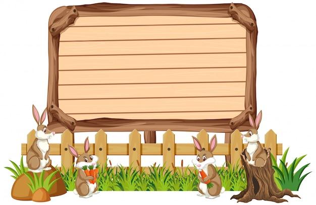 公園で多くのウサギと木製看板テンプレート
