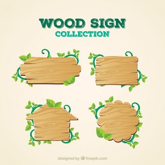 Wooden signs with branches and leaves