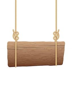 Деревянная подушка висит на веревках.