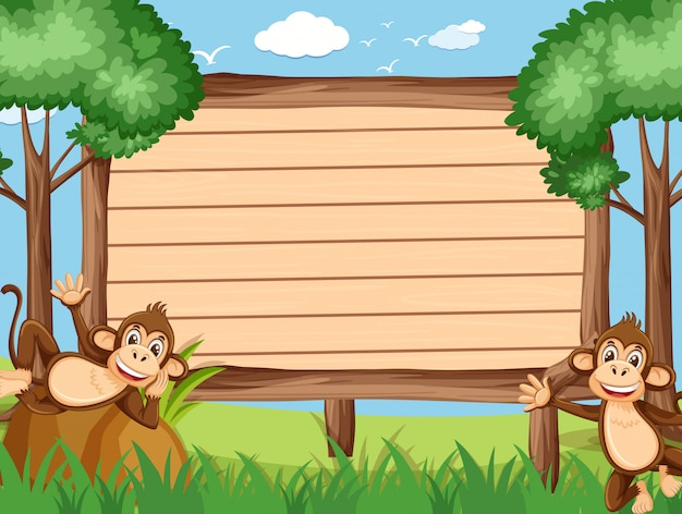 公園で幸せな猿と木製のテンプレート