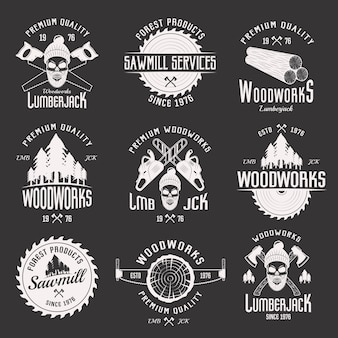 Woodworks monochrome emblems of sawmill and lumberjack services with working tools isolated