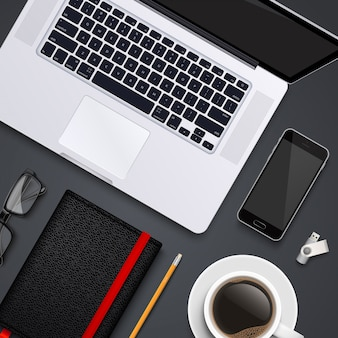 Рабочий стол с ноутбуком, телефоном, карандашом, очками, блокнотом, флешкой и кофейной чашкой. шаблон вида сверху.