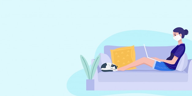 Work from home concept, a young woman sitting on sofa and working on laptop.