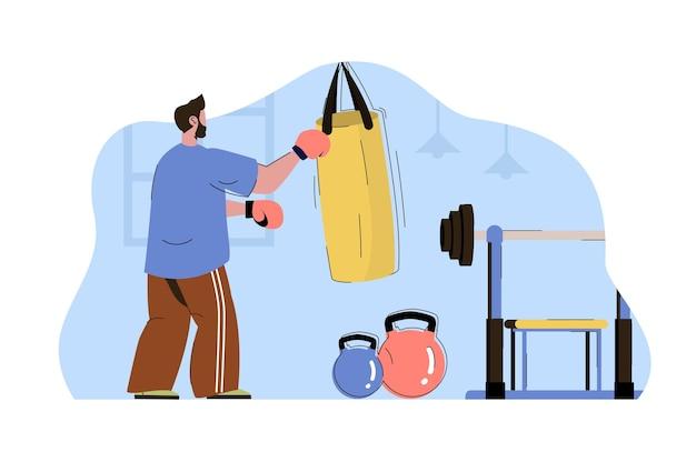 Упорно работать концепция человек упражнения с боксерской грушей в тренажерном зале