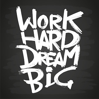 Work hard dream big phrase on blackboard