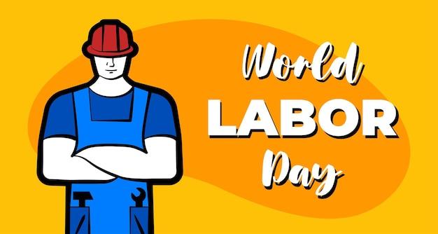 빨간색 건설 헬멧과 비문 세계 노동절을 쓴 노동자 남자는 전문 노동을 할 수 있습니다