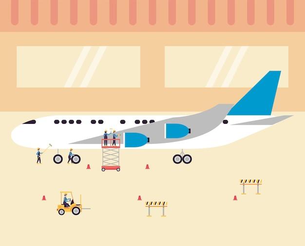 飛行機を掃除する労働者