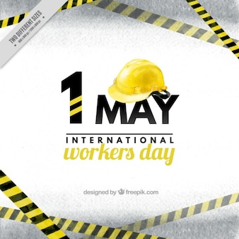 Workers day background with a yellow helmet