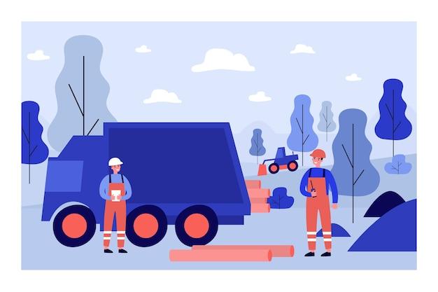 パイプラインの図を敷設する労働者
