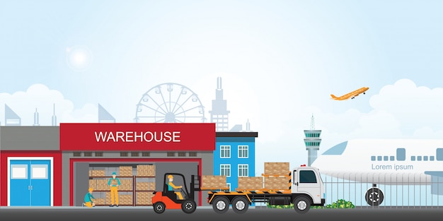 Workers loading the truck with packaged goods at warehouse building.