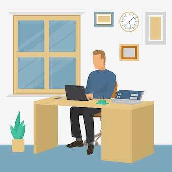 Работающий бизнесмен с ноутбуком, сидя за столом в офисе по работе