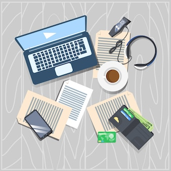 Workplace concept top angle view laptop computer papers wallet and cell smart phone working desk